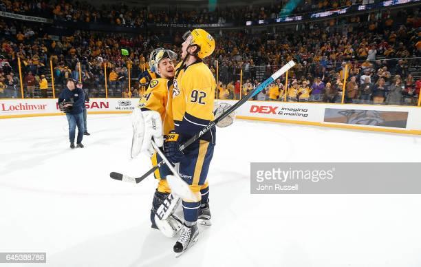 Ryan Johansen celebrates a 52 win with Juuse Saros of the Nashville Predators against the Washington Capitals during an NHL game at Bridgestone Arena...