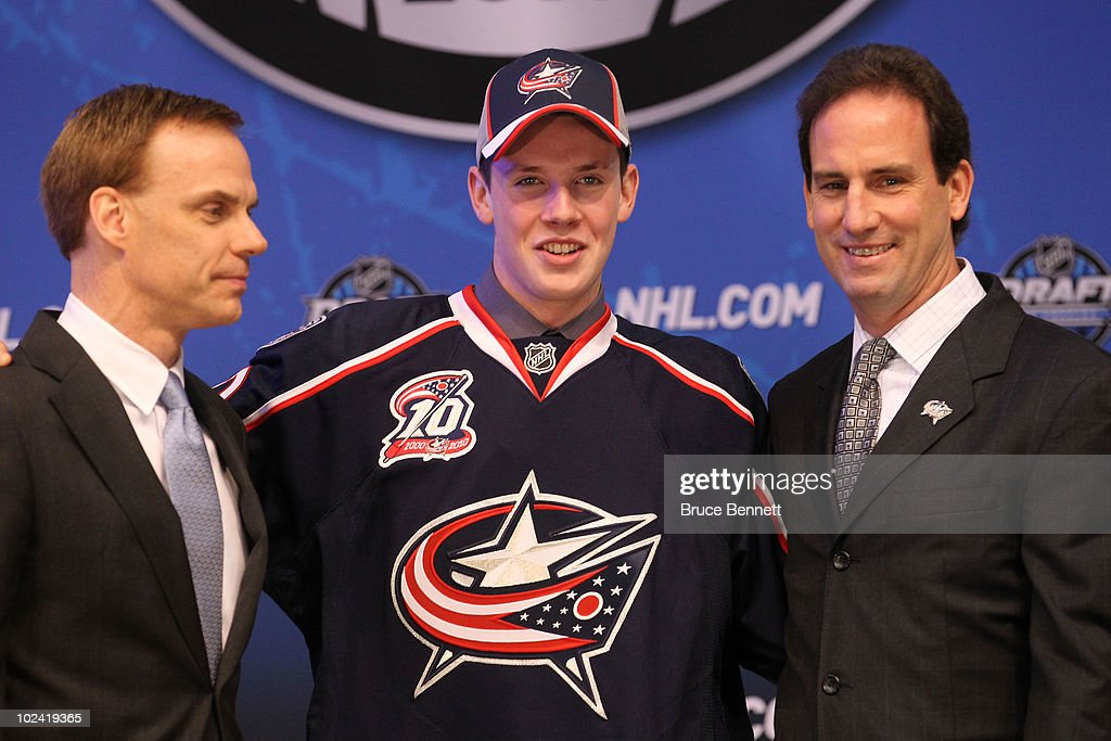 Ryan Johansen, drafted fourth overall by the Columbus Blue Jackets, poses on stage with team personnel during the 2010 NHL Entry Draft at Staples Center on June 25, 2010 in Los Angeles, California.