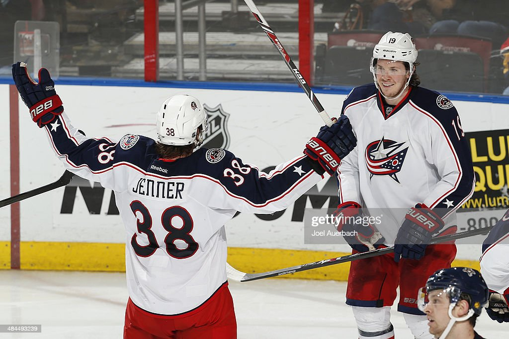 <a gi-track='captionPersonalityLinkClicked' href=/galleries/search?phrase=Ryan+Johansen&family=editorial&specificpeople=6698841 ng-click='$event.stopPropagation()'>Ryan Johansen</a> #19 is congratulated by <a gi-track='captionPersonalityLinkClicked' href=/galleries/search?phrase=Boone+Jenner&family=editorial&specificpeople=6480665 ng-click='$event.stopPropagation()'>Boone Jenner</a> #38 of the Columbus Blue Jackets after he scored the game winning goal in the third period against the Florida Panthers at the BB&T Center on April 12, 2014 in Sunrise, Florida. The Blue Jackets defeated the Panthers 3-2.