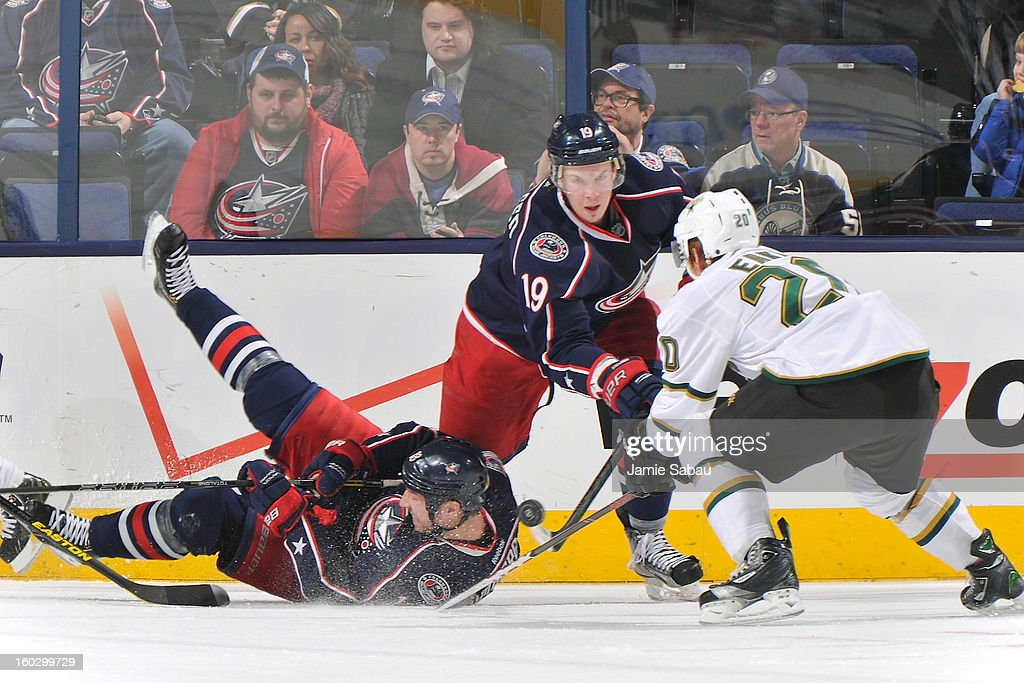 Ryan Johansen #19 of the Columbus Blue Jackets and Cody Eakin #20 of the Dallas Stars battle for a loose puck over a fallen R.J. Umberger #18 of the Columbus Blue Jackets on January 28, 2013 at Nationwide Arena in Columbus, Ohio. Columbus defeated 2-1.