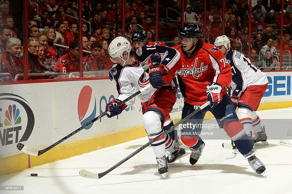 <a gi-track='captionPersonalityLinkClicked' href=/galleries/search?phrase=Ryan+Johansen&family=editorial&specificpeople=6698841 ng-click='$event.stopPropagation()'>Ryan Johansen</a> #19 of the Columbus Blue Jackets and John Carlson #74 of the Washington Capitals battle for the puck in the third period during an NHL game at Verizon Center on November 12, 2013 in Washington, DC.