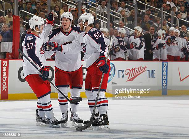Ryan Johansen of the Columbus Blue Jackets celebrates his goal with Ryan Murray and David Savard during the first period against the Pittsburgh...