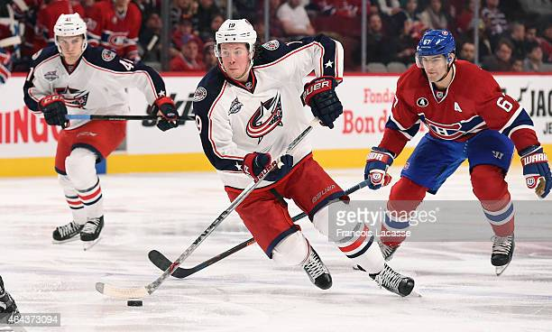 Ryan Johansen of the Columbus Blue Jackets controls the puck while being challenged by Max Pacioretty of the Montreal Canadiens in the NHL game at...