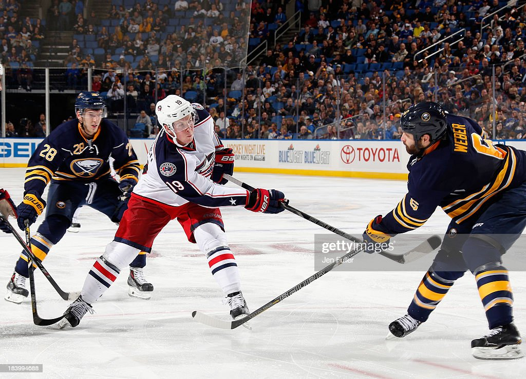<a gi-track='captionPersonalityLinkClicked' href=/galleries/search?phrase=Ryan+Johansen&family=editorial&specificpeople=6698841 ng-click='$event.stopPropagation()'>Ryan Johansen</a> #19 of the Columbus Blue Jackets fires a shot on net against Mike Weber #6 and <a gi-track='captionPersonalityLinkClicked' href=/galleries/search?phrase=Zemgus+Girgensons&family=editorial&specificpeople=8050732 ng-click='$event.stopPropagation()'>Zemgus Girgensons</a> #28 of the Buffalo Sabres at First Niagara Center on October 10, 2013 in Buffalo, New York. Columbus defeated Buffalo 4-1.