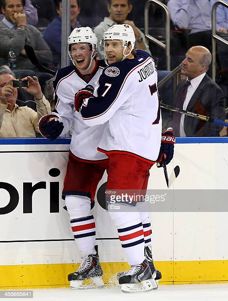 Ryan Johansen of the Columbus Blue Jackets is congratulated by teamamte Nick Foligno after Johansen scored in the third period against the New York...