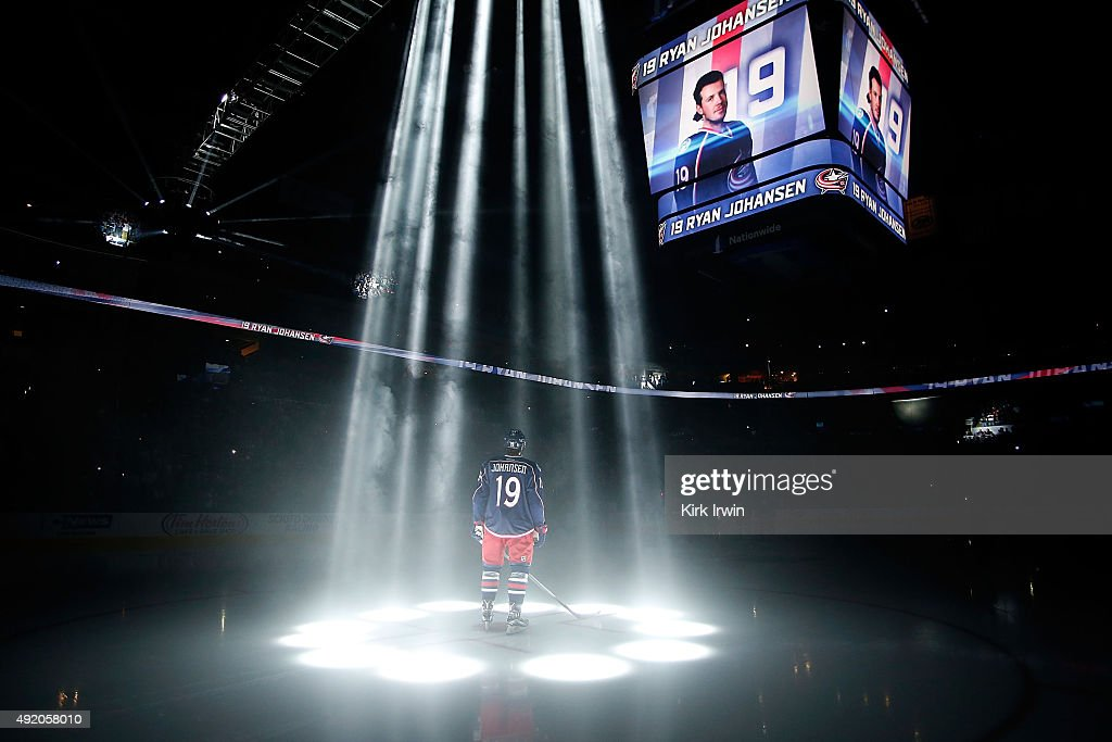 Ryan Johansen #19 of the Columbus Blue Jackets is illuminated by spot lights while being introduced to the crowd prior to the start of the game against the New York Rangers on October 9, 2015 at Nationwide Arena in Columbus, Ohio.
