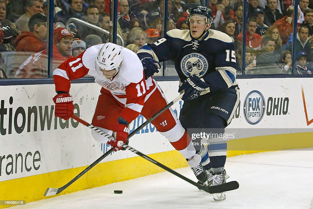 Ryan Johansen #19 of the Columbus Blue Jackets knocks down Daniel Cleary #11 of the Detroit Red Wings while battling for a loose puck during the third period on February 2, 2013 at Nationwide Arena in Columbus, Ohio. Columbus defeated Detroit 4-2.
