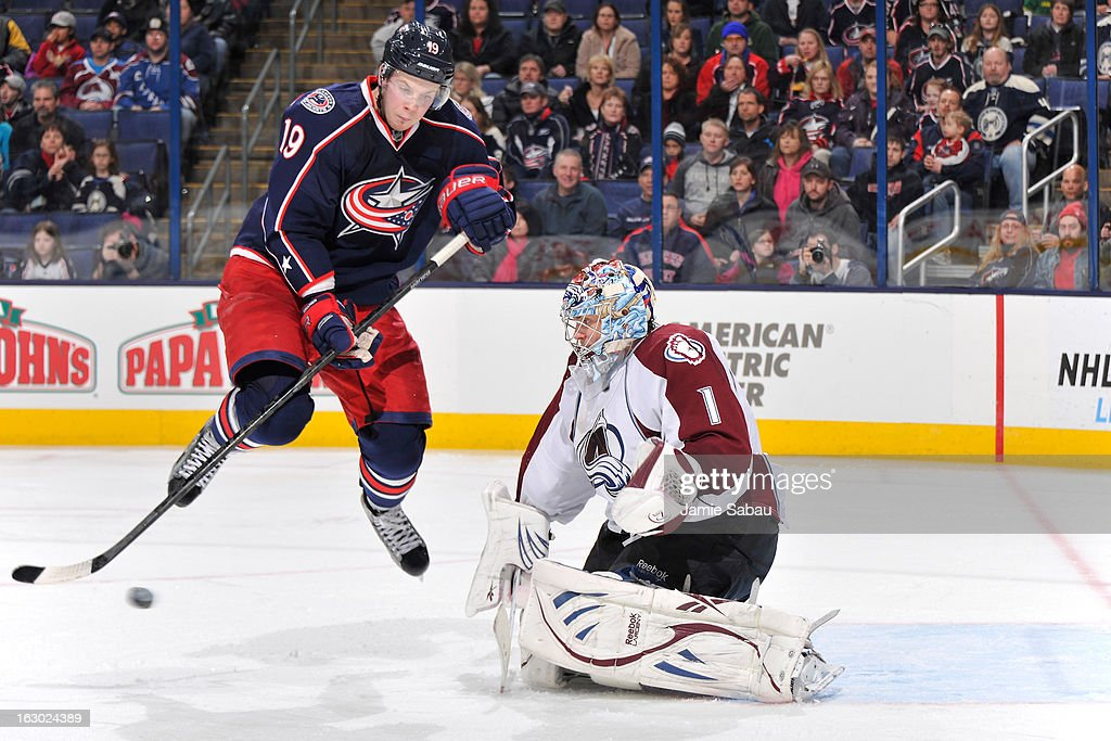 <a gi-track='captionPersonalityLinkClicked' href=/galleries/search?phrase=Ryan+Johansen&family=editorial&specificpeople=6698841 ng-click='$event.stopPropagation()'>Ryan Johansen</a> #19 of the Columbus Blue Jackets leaps as a shot from the point comes in to goaltender <a gi-track='captionPersonalityLinkClicked' href=/galleries/search?phrase=Semyon+Varlamov&family=editorial&specificpeople=6264893 ng-click='$event.stopPropagation()'>Semyon Varlamov</a> #1 of the Colorado Avalanche in the third period on March 3, 2013 at Nationwide Arena in Columbus, Ohio. Columbus defeated Colorado 2-1 in overtime.