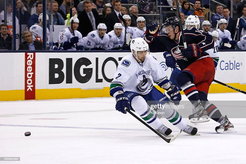 <a gi-track='captionPersonalityLinkClicked' href=/galleries/search?phrase=Ryan+Johansen&family=editorial&specificpeople=6698841 ng-click='$event.stopPropagation()'>Ryan Johansen</a> #19 of the Columbus Blue Jackets moves the puck past <a gi-track='captionPersonalityLinkClicked' href=/galleries/search?phrase=Dan+Hamhuis&family=editorial&specificpeople=204213 ng-click='$event.stopPropagation()'>Dan Hamhuis</a> #2 of the Vancouver Canucks during the second period on March 12, 2013 at Nationwide Arena in Columbus, Ohio.