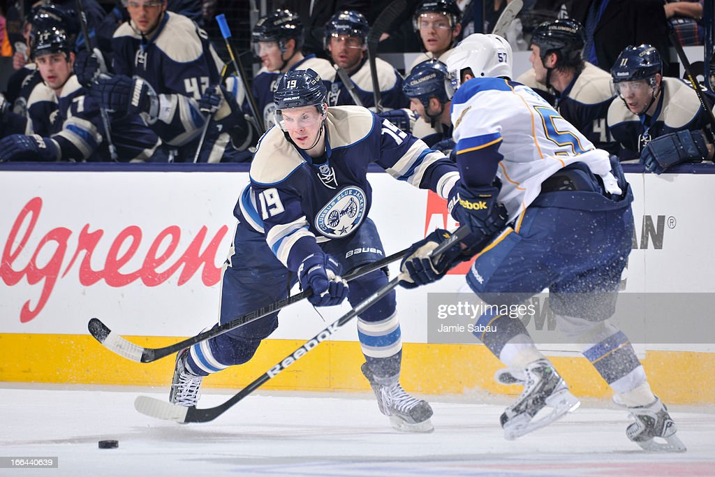 <a gi-track='captionPersonalityLinkClicked' href=/galleries/search?phrase=Ryan+Johansen&family=editorial&specificpeople=6698841 ng-click='$event.stopPropagation()'>Ryan Johansen</a> #19 of the Columbus Blue Jackets passes the puck up ice against the St. Louis Blues during the third period on April 12, 2013 at Nationwide Arena in Columbus, Ohio. Columbus defeated St. Louis 4-1.