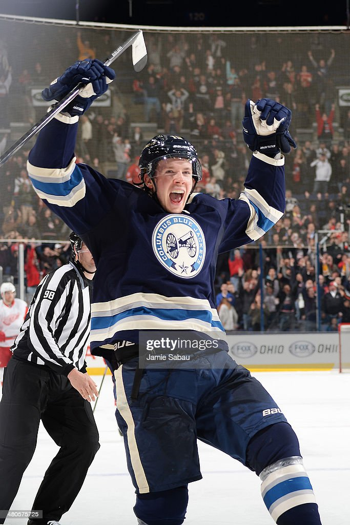 <a gi-track='captionPersonalityLinkClicked' href=/galleries/search?phrase=Ryan+Johansen&family=editorial&specificpeople=6698841 ng-click='$event.stopPropagation()'>Ryan Johansen</a> #19 of the Columbus Blue Jackets reacts after scoring an empty net goal against the Detroit Red Wings on March 25, 2014 at Nationwide Arena in Columbus, Ohio. Columbus defeated Detroit 4-2.