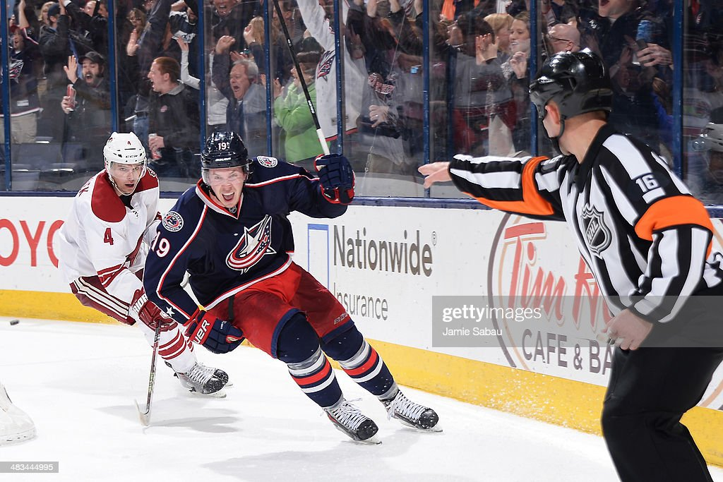 <a gi-track='captionPersonalityLinkClicked' href=/galleries/search?phrase=Ryan+Johansen&family=editorial&specificpeople=6698841 ng-click='$event.stopPropagation()'>Ryan Johansen</a> #19 of the Columbus Blue Jackets reacts after scoring the game-winning overtime goal against the Phoenix Coyotes on April 8, 2014 at Nationwide Arena in Columbus, Ohio. Columbus defeated Phoenix 4-3 in overtime.