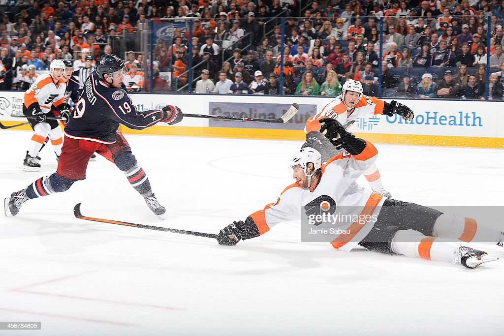 <a gi-track='captionPersonalityLinkClicked' href=/galleries/search?phrase=Ryan+Johansen&family=editorial&specificpeople=6698841 ng-click='$event.stopPropagation()'>Ryan Johansen</a> #19 of the Columbus Blue Jackets shoots his second goal of the game as <a gi-track='captionPersonalityLinkClicked' href=/galleries/search?phrase=Braydon+Coburn&family=editorial&specificpeople=2077063 ng-click='$event.stopPropagation()'>Braydon Coburn</a> #5 of the Philadelphia Flyers fails to block the shot during the third period on December 21, 2013 at Nationwide Arena in Columbus, Ohio. Columbus defeated Philadelphia 6-3.