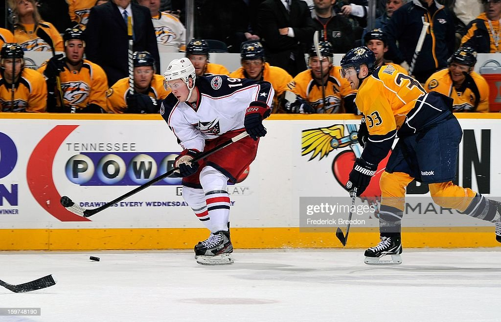 <a gi-track='captionPersonalityLinkClicked' href=/galleries/search?phrase=Ryan+Johansen&family=editorial&specificpeople=6698841 ng-click='$event.stopPropagation()'>Ryan Johansen</a> #19 of the Columbus Blue Jackets skates against Colin Wilson #33 of the Nashville Predators in the season opener at Bridgestone Arena on January 19, 2013 in Nashville, Tennessee.