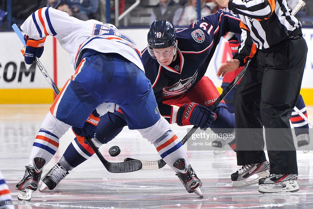 <a gi-track='captionPersonalityLinkClicked' href=/galleries/search?phrase=Ryan+Johansen&family=editorial&specificpeople=6698841 ng-click='$event.stopPropagation()'>Ryan Johansen</a> #19 of the Columbus Blue Jackets takes a faceoff against <a gi-track='captionPersonalityLinkClicked' href=/galleries/search?phrase=Sam+Gagner&family=editorial&specificpeople=4042961 ng-click='$event.stopPropagation()'>Sam Gagner</a> #89 of the Edmonton Oilers during the third period on March 5, 2013 at Nationwide Arena in Columbus, Ohio. Columbus defeated Edminton 4-3 in a shootout.