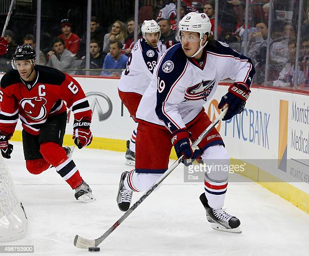 Ryan Johansen of the Columbus Blue Jackets takes the puck as Andy Greene of the New Jersey Devils defends in the first period on November 25 2015 at...
