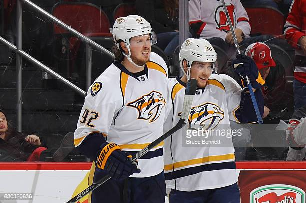 Ryan Johansen of the Nashville Predators celebrates his shorthanded goal at 1340 of the third period against the New Jersey Devils and is joined by...