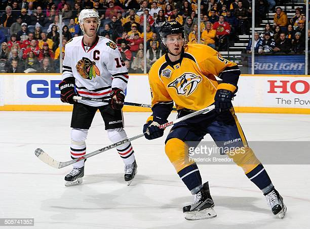 Ryan Johansen of the Nashville Predators skates against Jonathan Toews of the Chicago Blackhawks during the first period at Bridgestone Arena on...