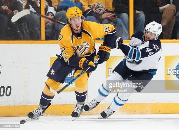 Ryan Johansen of the Nashville Predators skates against Josh Morrissey of the Winnipeg Jets during an NHL game at Bridgestone Arena on March 13 2017...