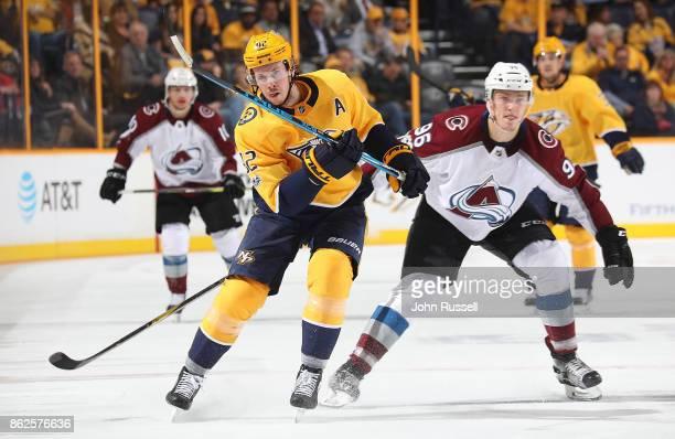 Ryan Johansen of the Nashville Predators skates against Mikko Rantanen of the Colorado Avalanche during an NHL game at Bridgestone Arena on October...