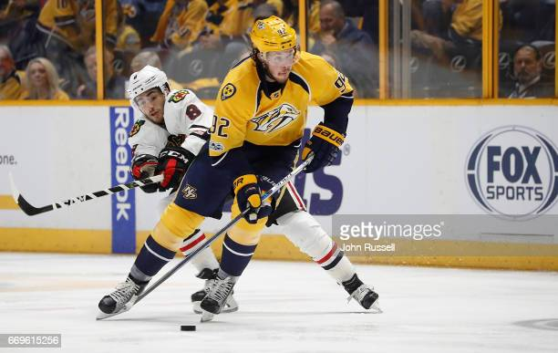 Ryan Johansen of the Nashville Predators skates against Nick Schmaltz of the Chicago Blackhawks in Game Three of the Western Conference First Round...