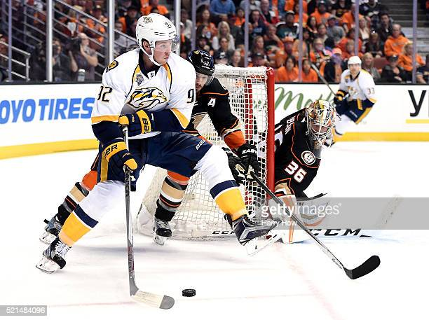 Ryan Johansen of the Nashville Predators skates from behind the net as he is watched by Ryan Kesler and John Gibson of the Anaheim Ducks during the...