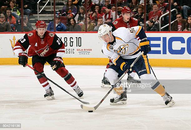 Ryan Johansen of the Nashville Predators skates with the puck in front of Oliver EkmanLarsson of the Arizona Coyotes during the second period at Gila...