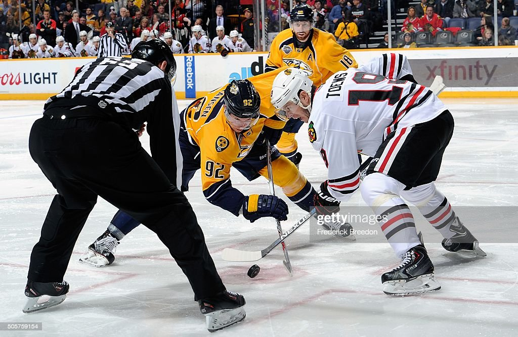 Ryan Johansen #92 of the Nashville Predators takes a faceoff against Jonathan Toews #19 of the Chicago Blackhawks during the third period at Bridgestone Arena on January 19, 2016 in Nashville, Tennessee.