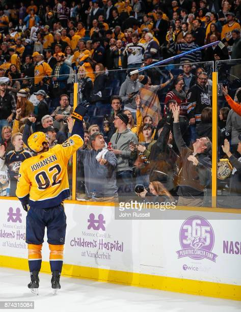 Ryan Johansen of the Nashville Predators tosses his Hockey Fights Cancer stick to a fan after a 63 win against the Washington Capitals during an NHL...