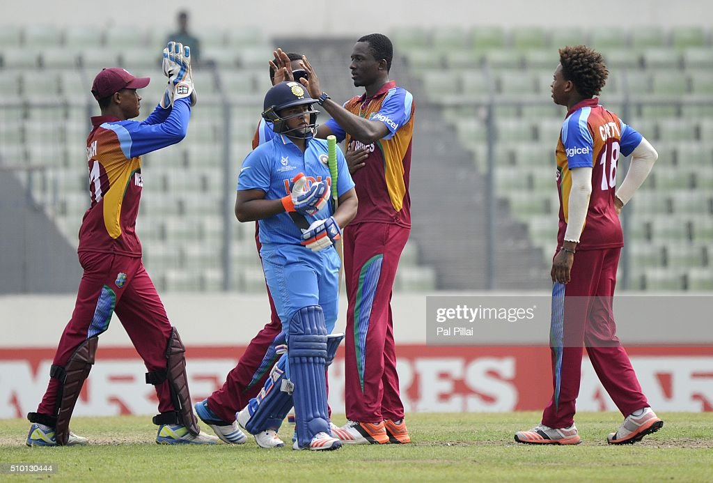 Ryan John of West Indies U19 celebrates the wicket of Sarfaraz Khan of India as the latter walks back after getting out during the ICC U19 World Cup Final Match between India and West Indies on February 14, 2016 in Dhaka, Bangladesh.