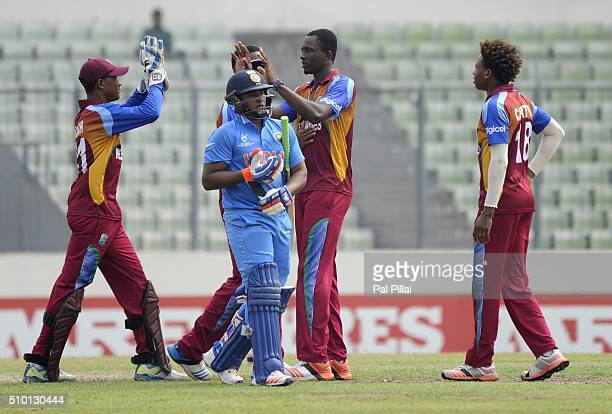 Ryan John of West Indies U19 celebrates the wicket of Sarfaraz Khan of India as the latter walks back after getting out during the ICC U19 World Cup...