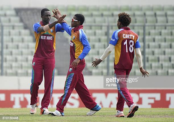 Ryan John of West Indies U19 celebrates the wicket of Sarfaraz Khan of India during the ICC U19 World Cup Final Match between India and West Indies...
