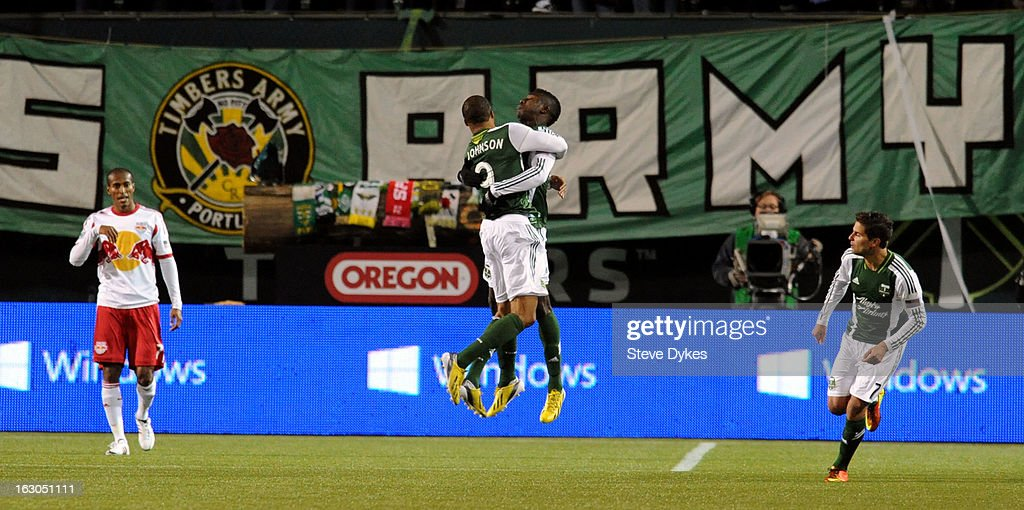 Ryan Johnson #9 of Portland Timbers and Jose Adolfo Valencia #20 of Portland Timbers celebrate the goal that tied the game during the second half of the game at Jeld-Wen Field on March 03, 2013 in Portland, Oregon. The game ended in a 3-3 draw.