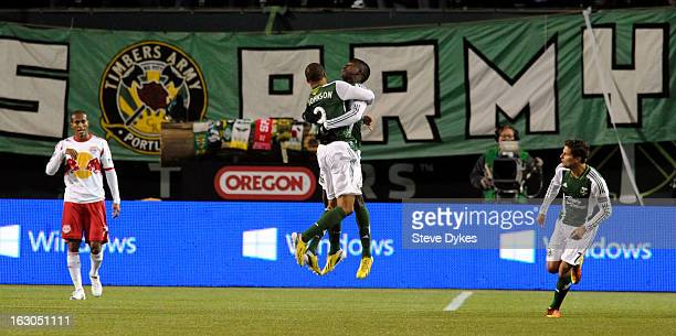 Ryan Johnson of Portland Timbers and Jose Adolfo Valencia of Portland Timbers celebrate the goal that tied the game during the second half of the...