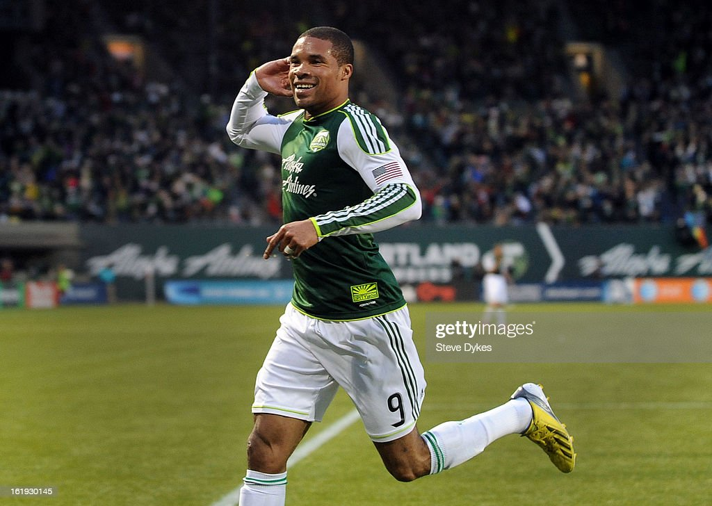 Ryan Johnson #9 of Portland Timbers celebrates after scoring his second goal of the game during the first half of the game against the San Jose Earthquakes at Jeld-Wen Field on February 17, 2013 in Portland, Oregon.