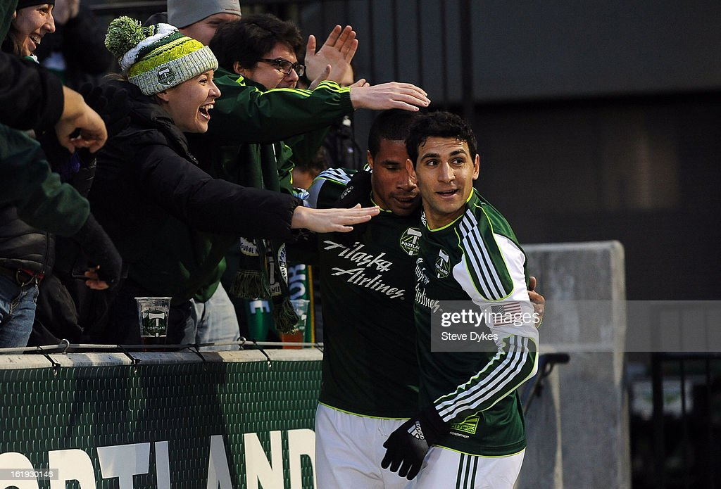 Ryan Johnson #9 of Portland Timbers celebrates with fans and Diego Valeri #8 of Portland Timbers after scoring his second goal of the game during the first half of the game against the San Jose Earthquakes at Jeld-Wen Field on February 17, 2013 in Portland, Oregon.