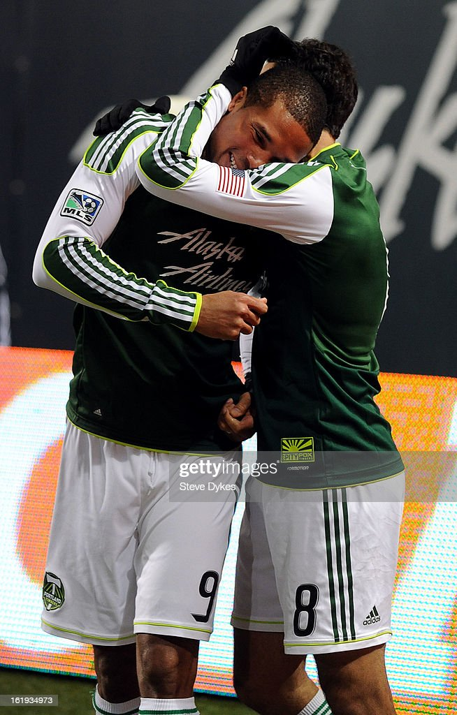 Ryan Johnson #9 of Portland Timbers celebrates with teammate Diego Valeri #8 of Portland Timbers after Johnson scored his third goal of the match during the second half of the game against the San Jose Earthquakes at Jeld-Wen Field on February 17, 2013 in Portland, Oregon. The match ended in a 3-3 draw. Photo by Steve Dykes/Getty Images)