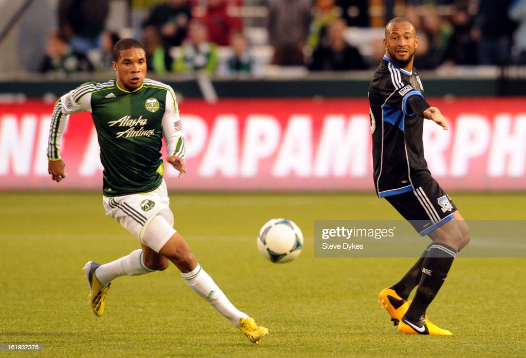 Ryan Johnson #9 of Portland Timbers dribbles the ball away from Justin Morrow #15 of San Jose Earthquakes during the first half of the game at Jeld-Wen Field on February 17, 2013 in Portland, Oregon.