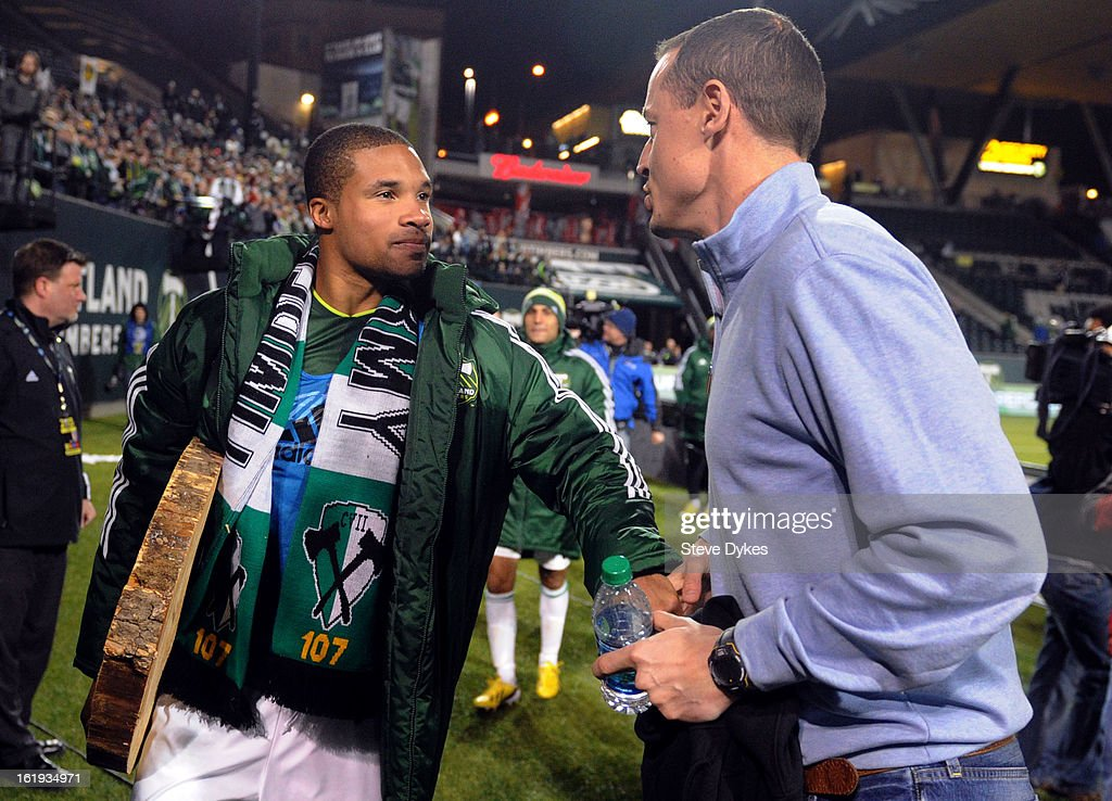Ryan Johnson #9 of Portland Timbers is greeted by The Timbers owner Merritt Paulson as he walks off the field after the match against the San Jose Earthquakes at Jeld-Wen Field on February 17, 2013 in Portland, Oregon. Johnson scored three goals in the match which ended in a 3-3 draw. Photo by Steve Dykes/Getty Images)