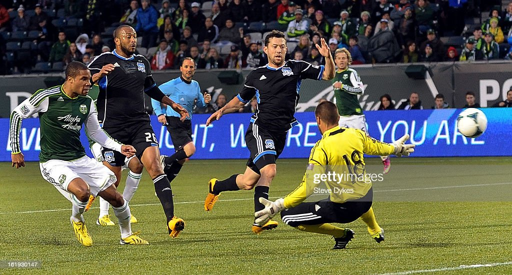 Ryan Johnson #9 of Portland Timbers kicks the ball past Jon Busch #18 of San Jose Earthquakes for his second goal of the game during the first half of the game at Jeld-Wen Field on February 17, 2013 in Portland, Oregon.