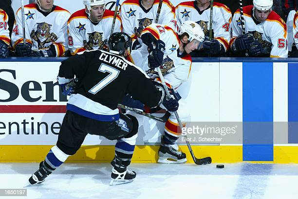 Ryan Johnson of the Florida Panthers passes past Ben Clymer of the Tampa Bay Lightning during the NHL game at the Office Depot Center on October 28...