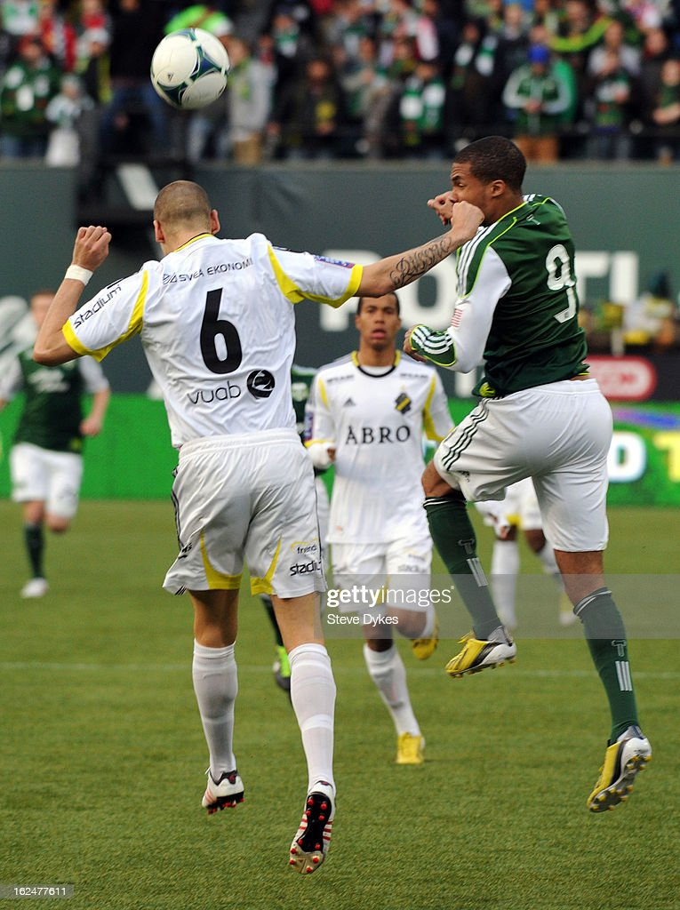 Ryan Johnson #9 of the Portland Timbers and Alexander Milosevic #6 of AIK go up for a ball during the first half of the game at Jeld-Wen Field on February 23, 2013 in Portland, Oregon.