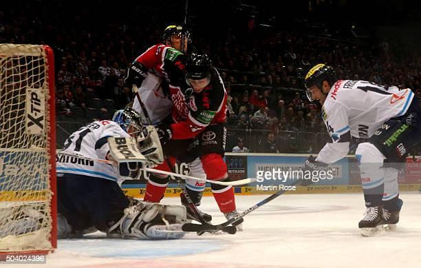 Ryan Jones of Koelner Haie fails to score over Timo Pielmeier goaltender of ERC Ingolstadt during the DEL Ice Hockey match between Koelner Haie and...