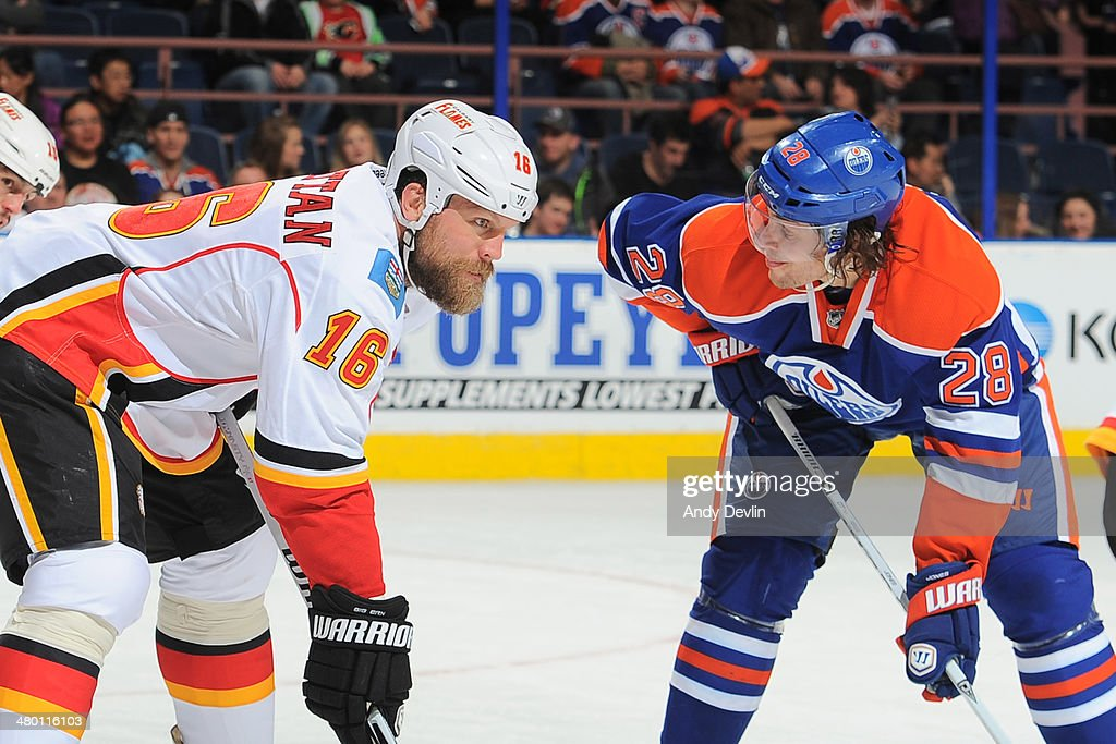 Ryan Jones #28 of the Edmonton Oilers lines up for a face off against <a gi-track='captionPersonalityLinkClicked' href=/galleries/search?phrase=Brian+McGrattan&family=editorial&specificpeople=598177 ng-click='$event.stopPropagation()'>Brian McGrattan</a> #16 of the Calgary Flames on March 22, 2014 at Rexall Place in Edmonton, Alberta, Canada.