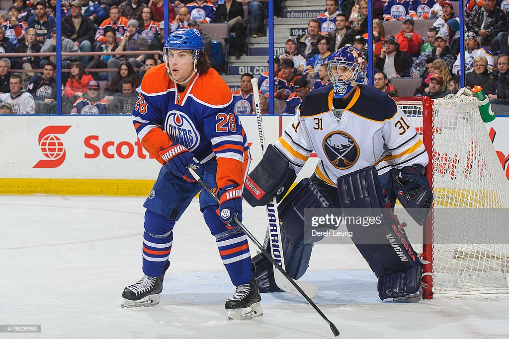 Ryan Jones #28 of the Edmonton Oilers looks for an opportunity in front of the net of Matt Hackett #31 of the Buffalo Sabres during an NHL game at Rexall Place on March 20, 2014 in Edmonton, Alberta, Canada.