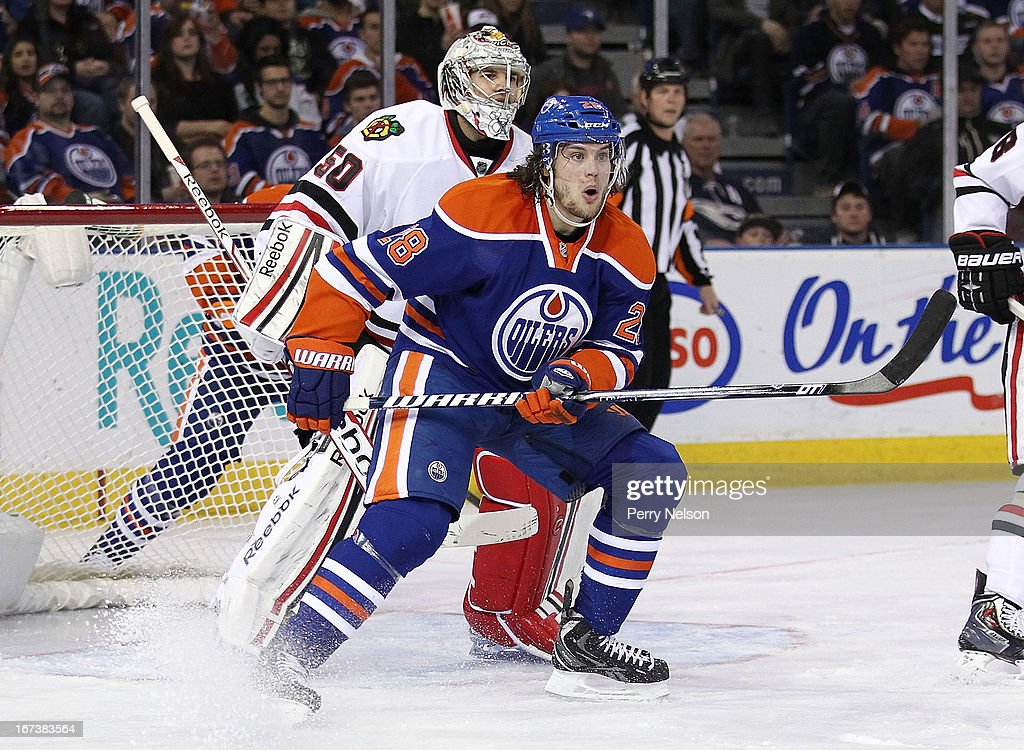 Ryan Jones #28 of the Edmonton Oilers screens goaltender <a gi-track='captionPersonalityLinkClicked' href=/galleries/search?phrase=Corey+Crawford&family=editorial&specificpeople=818935 ng-click='$event.stopPropagation()'>Corey Crawford</a> #50 of the Chicago Blackhawks at Rexall Place on April 24, 2013 in Edmonton, Alberta, Canada.