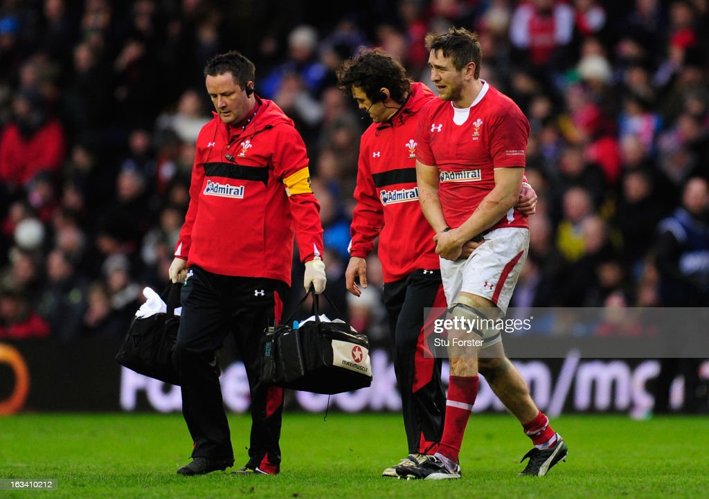 <a gi-track='captionPersonalityLinkClicked' href=/galleries/search?phrase=Ryan+Jones+-+Rugby+Player&family=editorial&specificpeople=218029 ng-click='$event.stopPropagation()'>Ryan Jones</a> of Wales goes off injured during the RBS Six Nations match between Scotland and Wales at Murrayfield Stadium on March 9, 2013 in Edinburgh, Scotland.