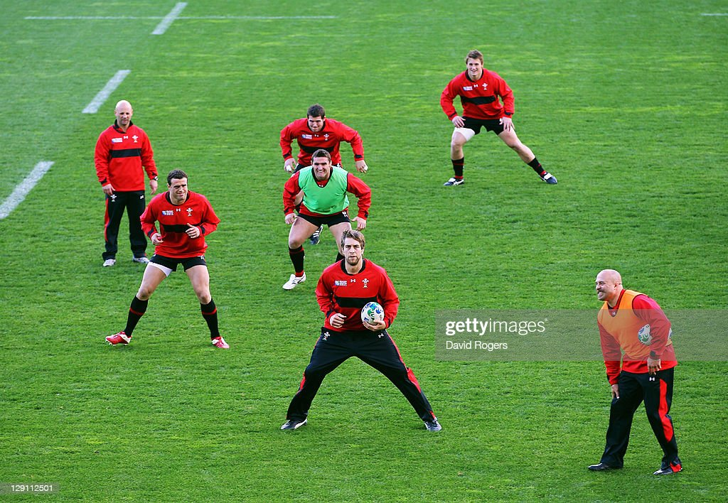 <a gi-track='captionPersonalityLinkClicked' href=/galleries/search?phrase=Ryan+Jones+-+Rugby+Player&family=editorial&specificpeople=218029 ng-click='$event.stopPropagation()'>Ryan Jones</a> of Wales holds the ball as players warm up during a Wales IRB Rugby World Cup 2011 training session at Mt Smart Stadium on October 13, 2011 in Auckland, New Zealand.