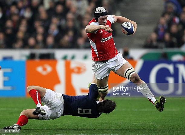 Ryan Jones of Wales is tackled by Morgan Parra of France during the RBS 6 Nations Championship match between France and Wales at Stade de France on...