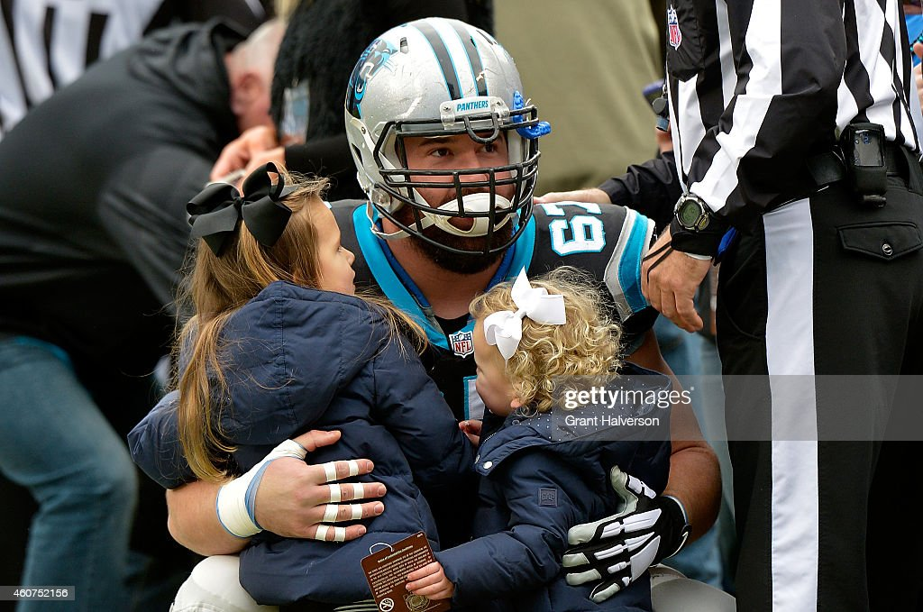 Ryan Kalil #67 of the Carolina Panthers says hello to some young fans before the game against the Cleveland Browns at Bank of America Stadium on December 21, 2014 in Charlotte, North Carolina.